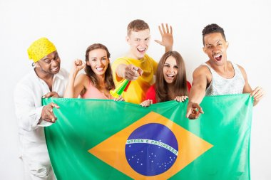 Group of multiracial people holding a Brazil flag