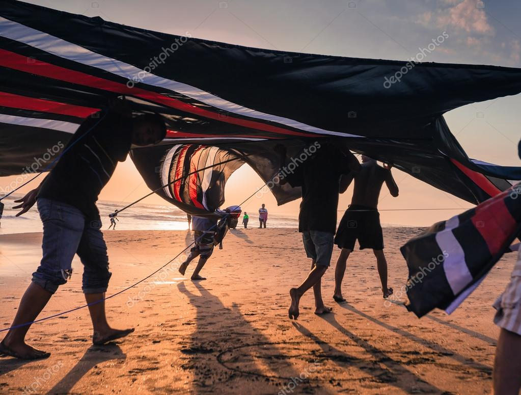 Indonesian boys going to fly a kite