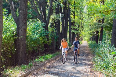 Yong couple travel by bicycle together