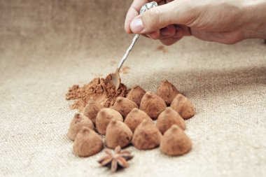 Chocolate truffles candies on a background of burlap bag texture