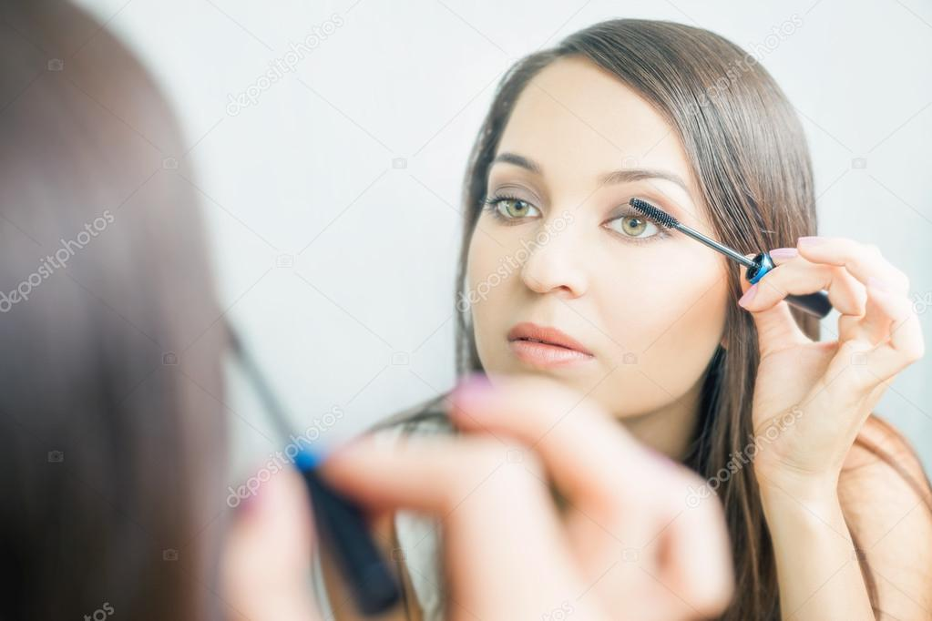 Makeup artist woman doing make up using cosmetic brush for yourself makeup artist woman doing make up using cosmetic brush for yourself stock photo solutioingenieria Image collections