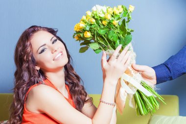 Beautiful happy woman received a flower bouquet of roses