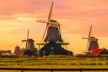 Dutch windmills against pink sky