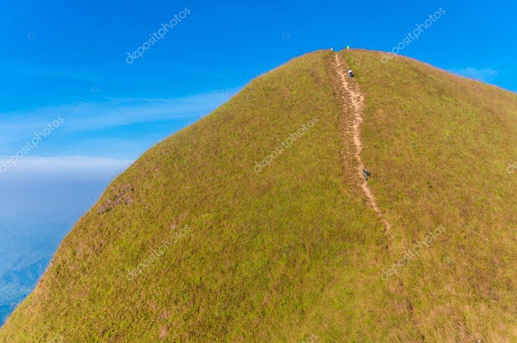 Tourists hiking on (Khao Chang Puak) of mountains at Kanchanaburi