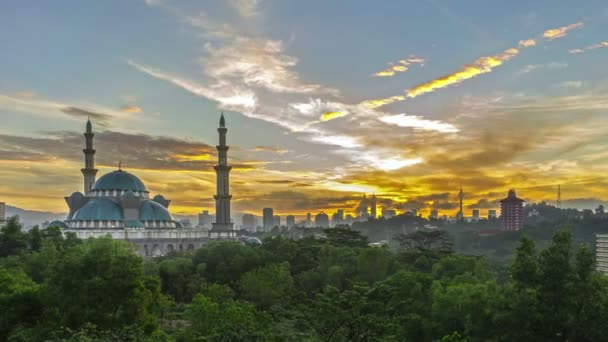 Time lapse. Sunrise at Federal Mosque, Kuala Lumpur with silhouette Kuala Lumpur city skyline. Zoom out