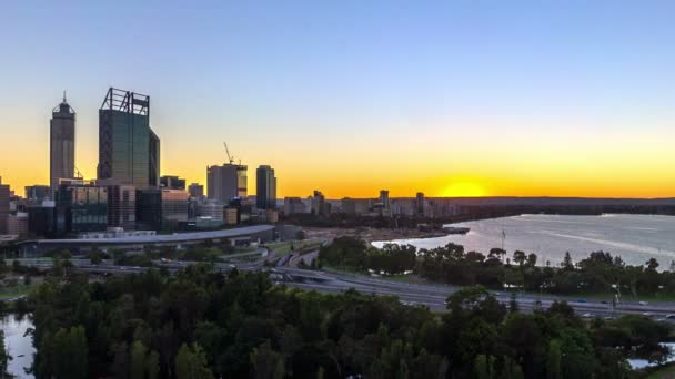 Time lapse HDFootage of beautiful dramatic Sunrise At Perth City, Australia With Zoom Out Effect. Taken from Kings Park And Botanic Garden. Showing a clear sun rise from the horizon line.