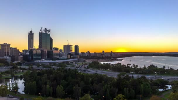 Time lapse HDFootage of beautiful dramatic Sunrise At Perth City, Australia. Taken from Kings Park And Botanic Garden. Showing a clear sun rise from the horizon line.