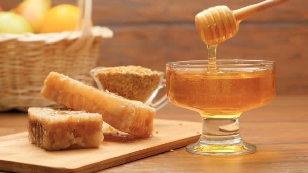 Composition of honey, honeycomb and bee bread. Honey pouring on honeycomb (No 4)