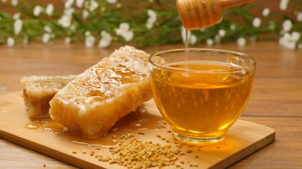Composition of honey and honeycomb. Honey pouring on honeycomb (No 12.1)