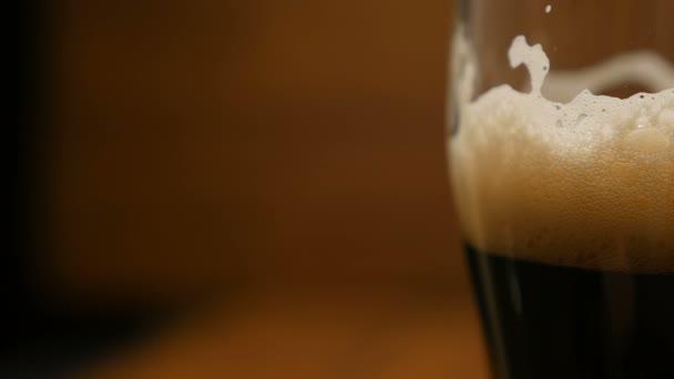 Glass of beer with foam (closeup, LR Pan)