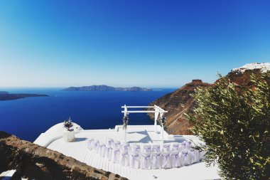 Wedding ceremony in santorini, chairs and arch