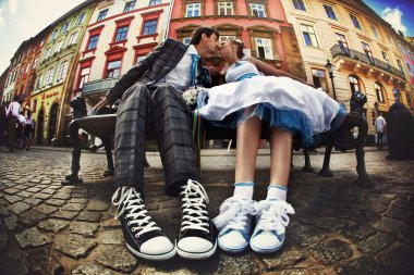 happy creative wedding couple, with converse sneakers old city b