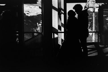 silhouette bride and groom in love