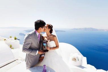 happy stylish asian bride and groom