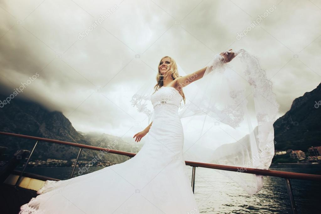 bride posing on the deck