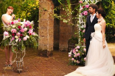 rich stylish happy bride and groom