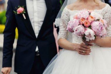 Elegant muscular groom and bride
