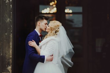 groom and bride outside church