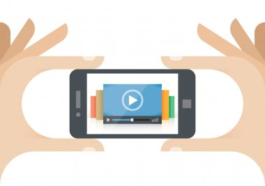 Human hands holding mobile phone with video player on the screen. Idea - Mobile collection of films, Cloud computing technologies for internet video streaming, Video news
