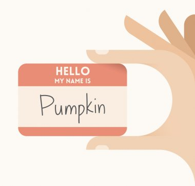 Children's hand holding card with text Hello my name is Pumpkin. Idea - Halloween celebration games and surprises.