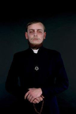 Halloween. A man dressed as the evil Catholic priest
