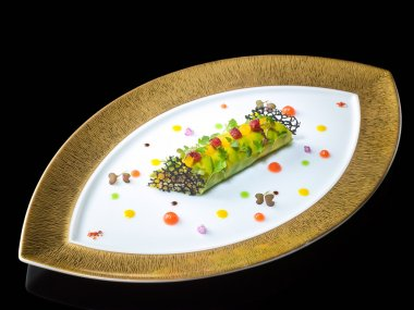 King crab and avocado cannelloni citrus and vanilla on oval plat