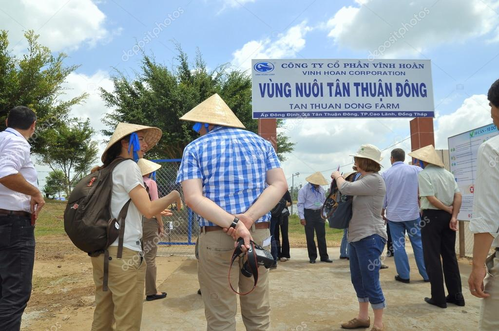 Dong Thap, Vietnam - March 1, 2013: International reporters and journalists are about to enter a pangasius catfish farm in the mekong delta of Vietnam