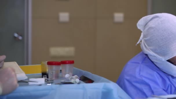 The doctor makes an operation