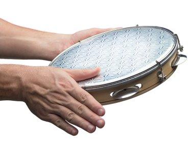 Tambourine in human hands
