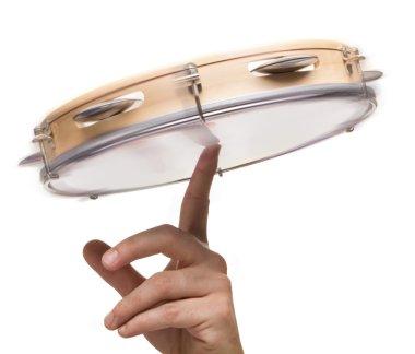 Tambourine on human hand