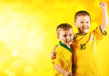 Boys in brazilian national football shirt