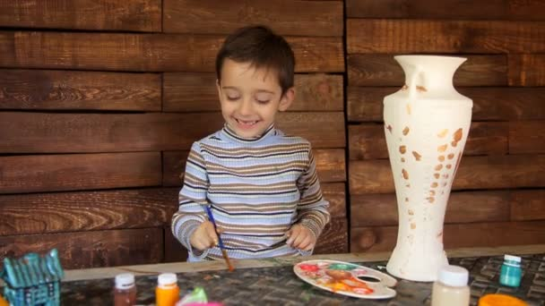 Father and son paint colors ceramic vase