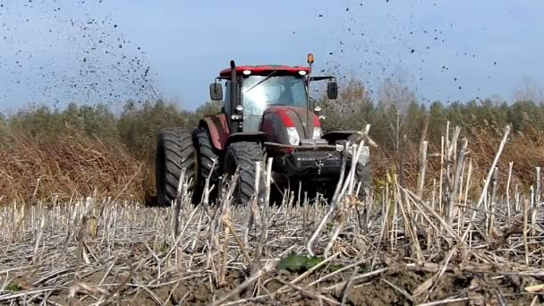 Tractor pulls a machine that cuts the channels in the field