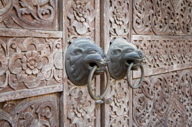 Close up traditional Thai style wooden door