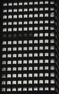 Windows of the night empty multi-storey skycraper building of glass and steel office lighting and with no people within stock vector