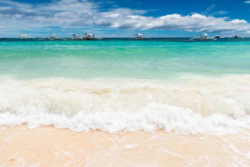 Paglao island at Alona beach with traditional boats