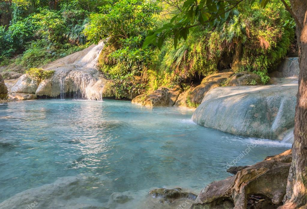 Jungle landscape with flowing turquoise water, Thailand