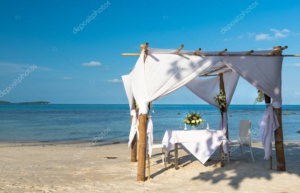 Wedding ceremony dining place on a tropical beach