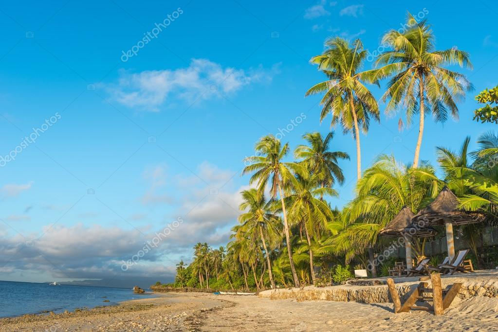 Anda White Beach at Bohol island with beach chairs