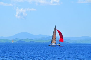 Red sailing yacht