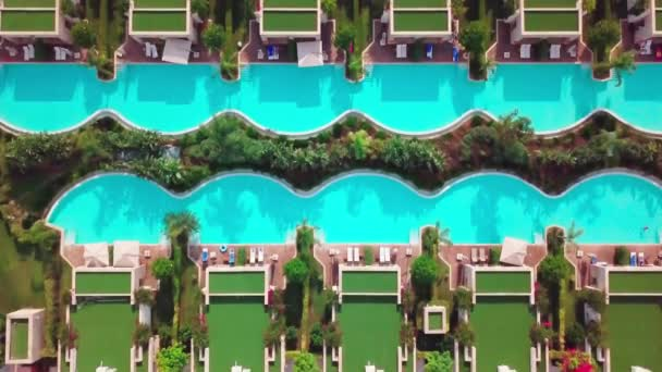 drone flies above the garden with swimming pools