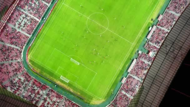 Aerial, top down, drone shot, above a game at a soccer field, inside a football stadium, at night time, in Portugal