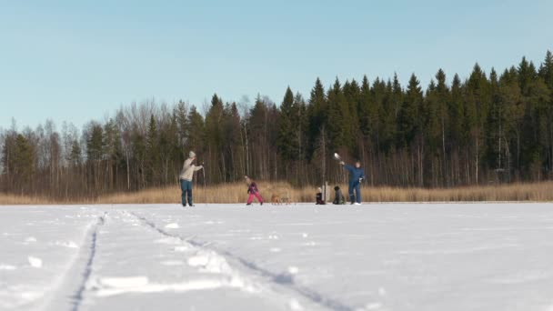 Multi generation family having fun playing with snow in winter scenery