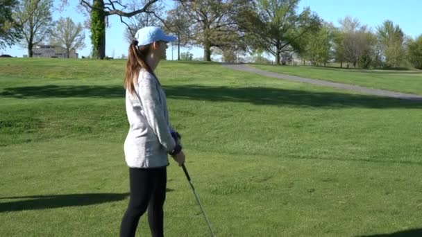 HD footage of woman at a golf course holding a golf club