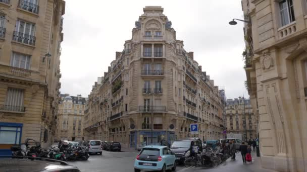 Typical Parisian Apartment Buildings On The Corner Of the Streets In Paris, France.  - wide shot
