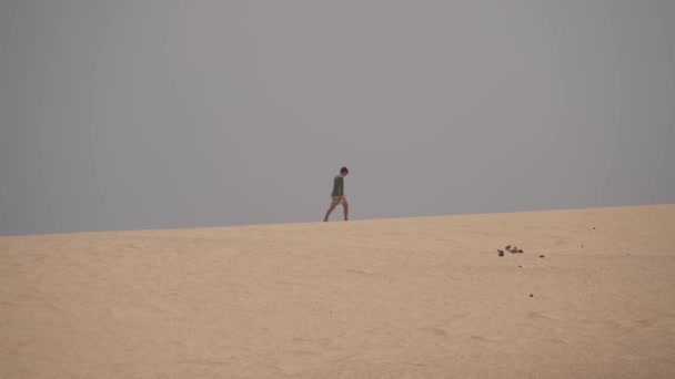 running over volcanic dunes and feeling the freedom in Fuerteventura, canary island.