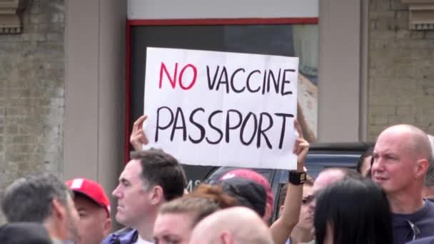 A protestor holds up a placard that says No vaccine passport on a Coronavirus conspiracy protest