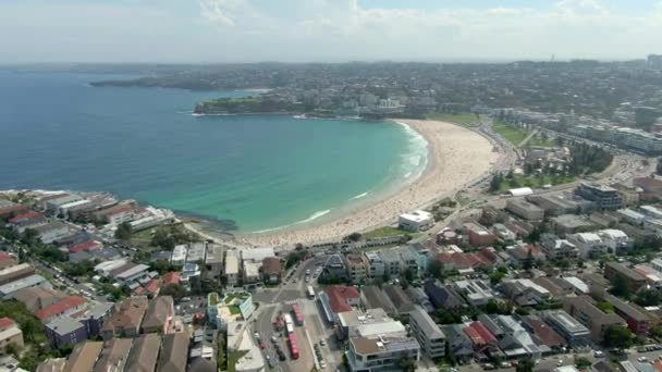 Aerial view of Bondi Beach or Bondi Bay at sunny day in Sydney.North Bondi and Bondi beach in Sydney eastern suburbs on Pacific coast facing open ocean elevated aerial drone flying towards waterfront.