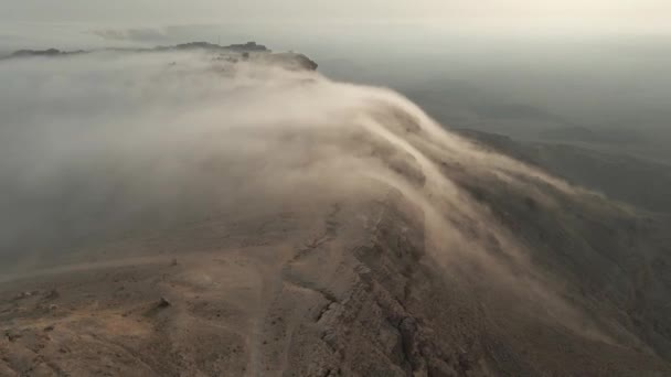 A Cloud Waterfall Phenomena over a cliff in Mitzpe Ramon, Israel