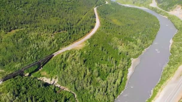 4K Drone Video of Train Trestle bridge and Mountains Rising above the Chulitna River near Denali National Park and Preserve, AK during Summer